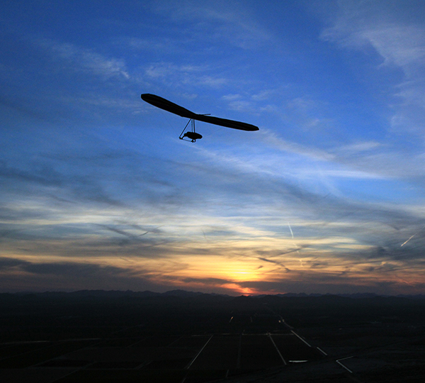 Hang glide at sunset